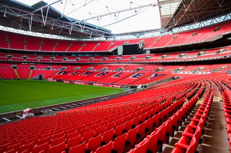 FEB 24, 2011 LONDON, UK : Red seat and interior of Wembley football stadium, London UK.
