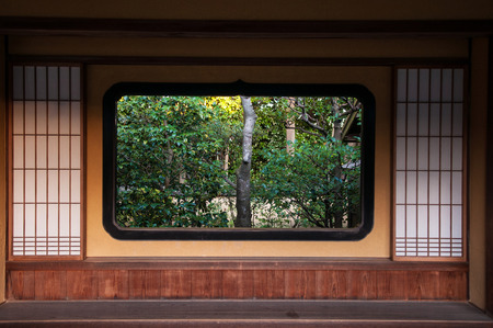 Japanese Garden Visible Through The Japanese style window and wall. 写真素材