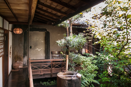 Old Japanese house and bamboo water fountain