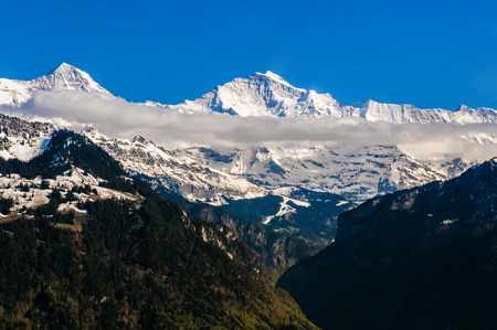 Monch and Jungfraujoch peak cover with snow, view from Harder Kulm. Stock Photo