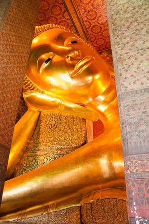 Golden Reclining Buddha at Wat Pho, Bangkok, Thailand.