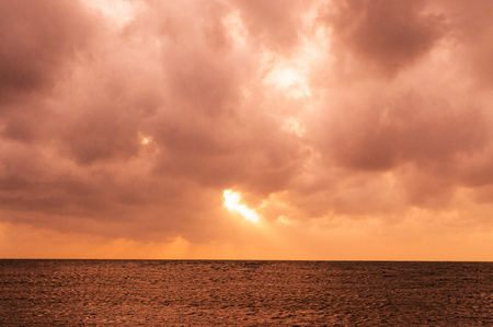 trat: Beach with dramatic sunset sky Stock Photo