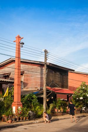 MAY 20, 2014 Koh Lanta, Thailand : Koh Lanta City, Koh Lanta old town wooden house along the street in fisherman village with tourists exploring and taking photo Editorial