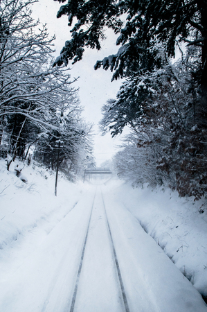 White Snow covered tracks on Tsugaru railway line in Aomori, Tohoku, Japan