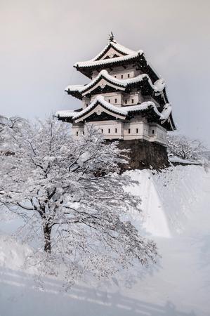 Architecture of Hirosaki Castle in winter season, whole area covered with white beautiful snow, Aomori, Tohoku, Japan