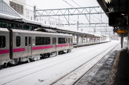 Pink strip commuter train in winter
