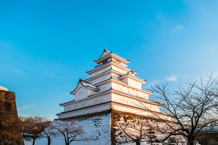Evening Winter sky at Japanese Castle tower of Aizu Wakamatsu Castle in Fukushima, Tohoku, Japan