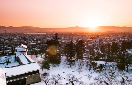 Sunset view of Aizu Wakamatsu city and castle park from aerial angle with beautiful evening light