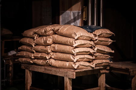 Grunge shot of Japanese rice sack old barn with dark and low key light