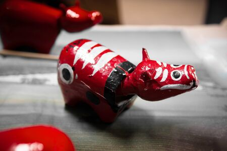 Red color Akabeko, traditional Japanese paper mache cow toy of Fukushima, Tohoku region 写真素材