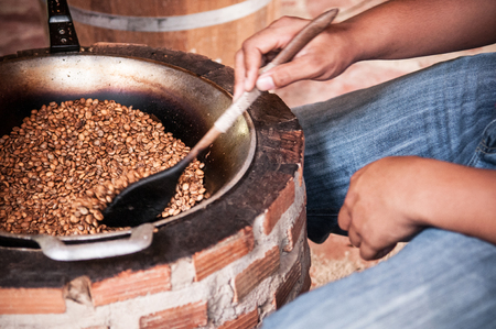 Hand roasted coffee beans, vintage coffee roasting process in Ranong, Thailand