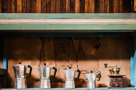 Old vintage coffee Moka pots in an old cupboard