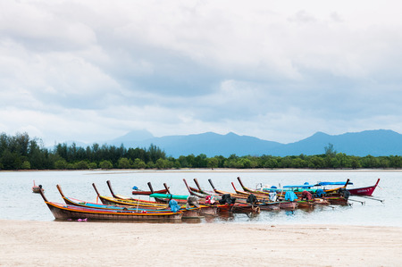 Thai Longtail Fishing Boat by the beach in Ranong province, Thailand.
