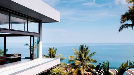 Mar 31, 2014 Phuket, Thailand : Living room in the modern villa with sea view, shot from outside of a luxury resort by the Andaman sea Editorial