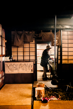 JAN 24, 2014 Fukushima, Japan : Japanese style room with Tatami and traditional fireplace, low key light, warm atmosphere