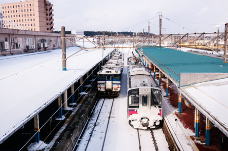 JAN 23, 2014 : Sakata, Yamagata, Japan : Pink strip JR East 701 Series commutor train at Sakata Station in winter, EMU train opperated on Ou Main Line between Akita and Aomori