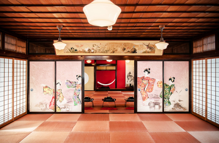 JAN 23, 2014 : Sakata, Yamagata, Japan : Japanese vintage tea room with wall painting  and traditional decoration, tables and seat pad. Mostly use as living room, meeting room or dinner room.