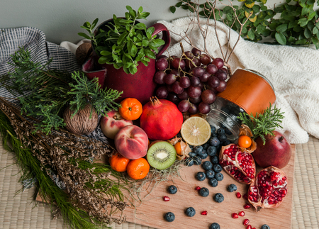 Healthy eating theme with different kind of fruits on wooden background. Copy space