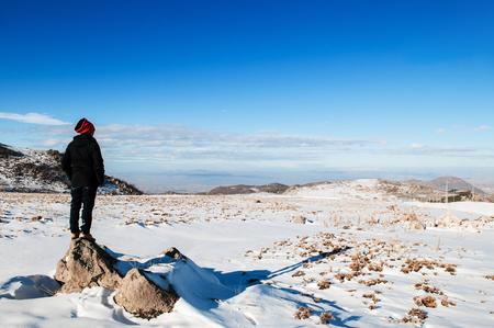 JAN 3, 2018 Kayseri, Turkey : Tourist explore Mt. Erciyes volcano covered with snow in mid winter Stock Photo