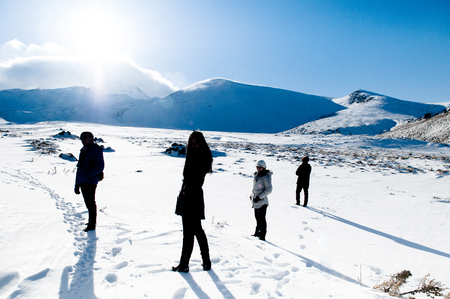 JAN 3, 2018 Kayseri, Turkey : Silhouette image Tourists on Mt. Erciyes volcano covered with snow in winter,