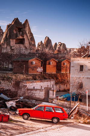 JAN 3, 2018 Goreme, Nevsehir, Turkey : Local house, Red car Goreme Cappadocia, Turkey in a beautiful winter day
