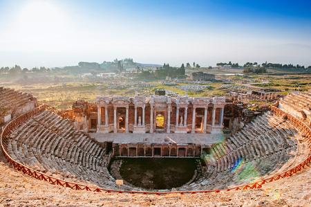 Ruins of ancient Hierapolis Amphi theatre with tourist Pamukkale, Denizili, Turkey