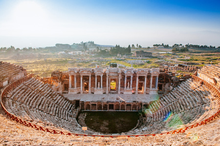 Ruins of ancient Hierapolis Amphi theatre with tourist Pamukkale, Denizili, Turkey