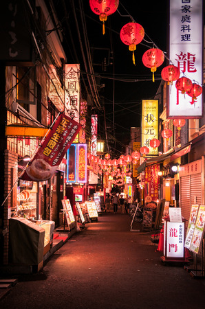 Yokohama, JAPAN - June 26, 2014 : Restaurant street - small alley with Chinese lanterns in China town Yokohama at night. Famous for delicious chinese food and shopping spot for tourist.