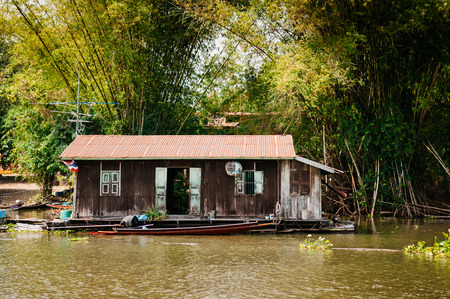 MAR 2, 2018 Uthaithani - Thailand : Traditional vinatge local floating house or raft house in river