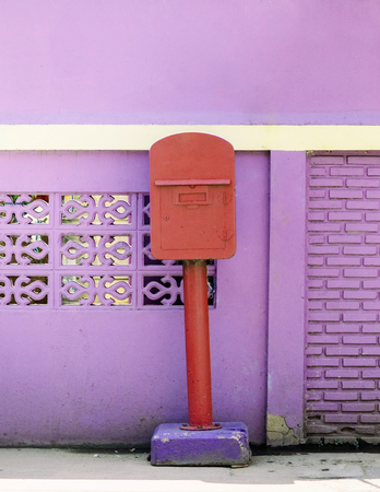 Red colour post box of Uthaithani province, only place in Thailand that use purple colour post box Reklamní fotografie - 97488172