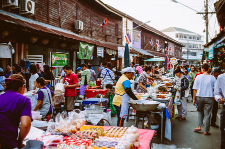 MAR 2, 2018 Uthaithani, THAILAND : Lively Local Thailand street food vintage old market, many buyers, sellers