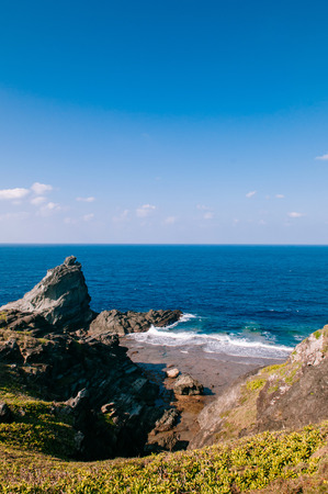 Beautiful scenery of Oganzaki cape and sea cliff on sunny day. Ishigaki island, Okinawa, Japan
