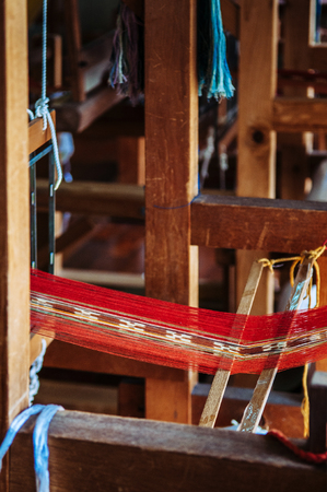 Handmade Okinawa traditional silk fabric, vintage silk weaved loom machine. close up textiles texture details
