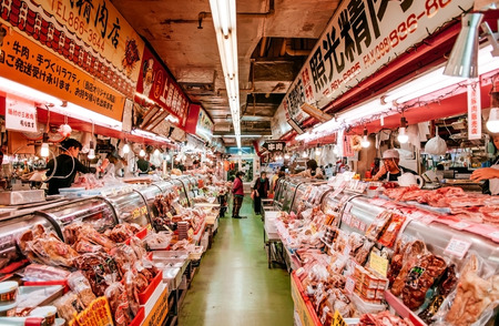 JAN 28, 2018 Naha, Okinawa, JAPAN : Local fish and seafood shop with customers in First Makishi Public Market