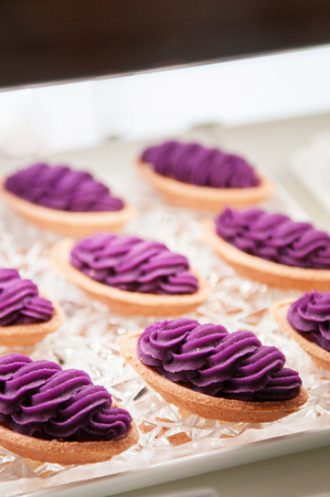 Famous Okinawa Beni Imo tart or sweet purple yam tart, beautiful arrange on tray