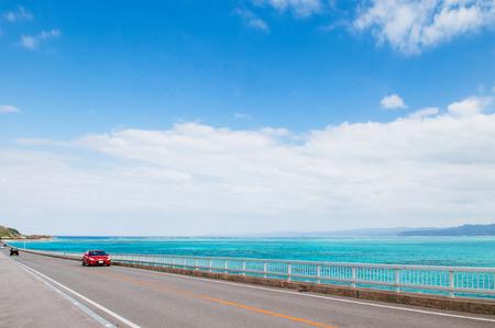 Kouri bridge cross over beautiful turqouise blue sea to Kouri island, Naha, Okinawa, Japan