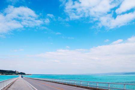 Kouri bridge cross over beautiful turqouise blue sea to Kouri island, Naha, Okinawa, Japan