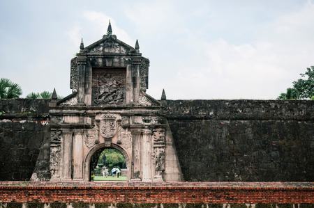 NOV 20, 2012 Manila, Philippines : Old historic entrance gate and moat of Fort Santiago with tourist in Intramuros district