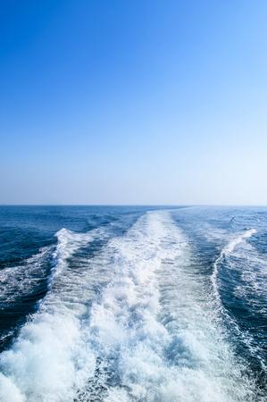 Strong wake from speedboat in blue ocean Corregidor Island, Manila, Philippines Stock Photo