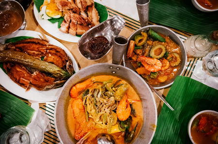 Meal set of various traditional Filippino Food,  Pakbet, lechon kawali, Bale Dutung. Top view