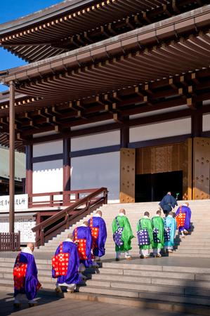 DEC 12, 2012 Narita, Chiba, JAPAN - Old beautiful historic Goma prayer ritual Monk with red umbrella walking to main hall of Narita san Shinsho ji temple