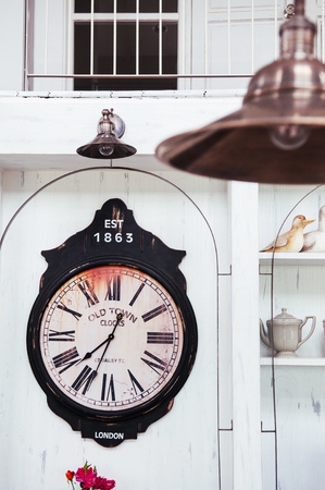 Old Retro vintage clock on white wall in country house 写真素材