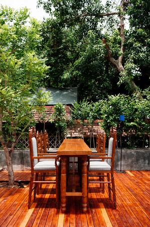 JUN 5, 2013 Chiang Mai, THAILAND - Garden furniture in the garden, Rustic Teak wood table and chairs