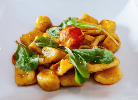 Sweet Potato gnocchi with spinach octopus butter and parmesan cheese and herbs