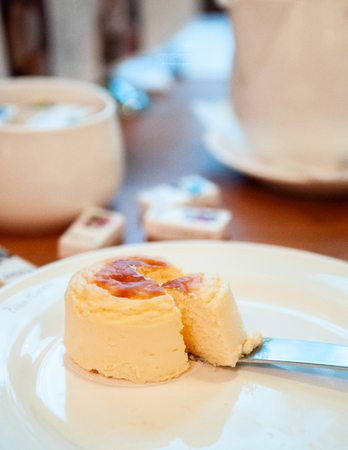 Delicious beautiful piece of Japanese Hakodate cheese cake fluffy, lite and soft Stock Photo