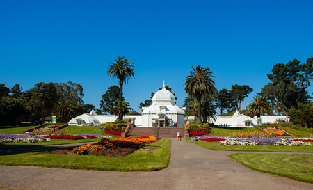 White glass house of San Francisco Conservatory of Flowers in summer, California, USA.