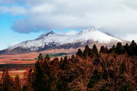 Mount Komagatake of Hakodateyama Hokkaido in winter with dry beautiful colored forest 版權商用圖片