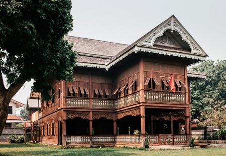 MAR 25, 2013 Phrae, Thailand - Old grunge Thai northern style teak wood historic house - Khum Vichairacha Editorial