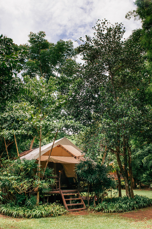 JUL 13,2013 Kanchanaburi, Thailand - Luxurious camping resort in nature forest, glamping vacation in tropical asian country Editorial