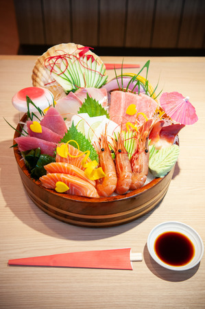 Food shot of Premium Japanese seafood Sashimi, salmon, shrimp, Tuna, Otoro on ice in bowl.